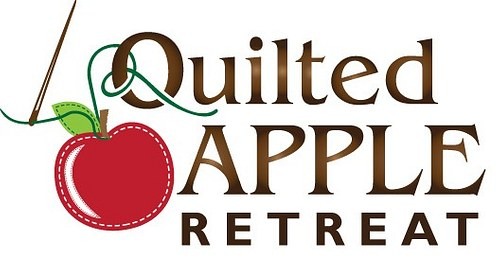 The Quilted Apple Retreat logo