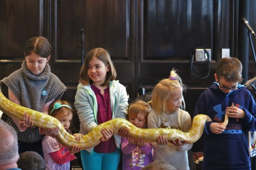 Group of Kids holding Snake on Family Day