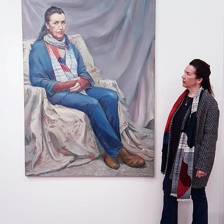 Lucy with her portrait at Kirkby Art Gallery. March 2020